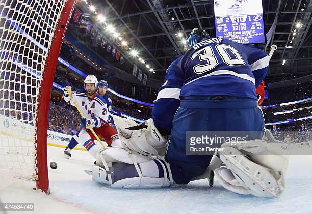 Martin St Louis of the New York Rangers misses a shot against Ben Bishop of the Tampa Bay Lightning in Game Four of the Eastern Conference Finals...
