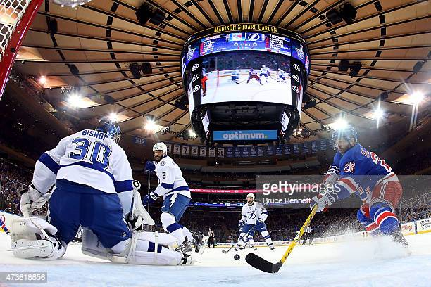 Martin St Louis of the New York Rangers skates in on Ben Bishop of the Tampa Bay Lightning in the first period of Game One of the Eastern Conference...