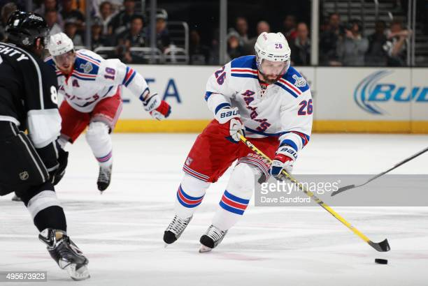 Martin St Louis of the New York Rangers skates with the puck during the second period of Game One of the 2014 Stanley Cup Final against the Los...