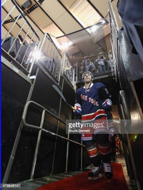 Martin St Louis of the New York Rangers walks out for warmups prior to his first game with the team against the Toronto Maple Leafs at Madison Square...