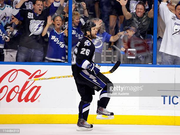 Martin St Louis of the Tampa Bay Lightning celebrates a goal in the third period against the Boston Bruins in Game Four of the Eastern Conference...
