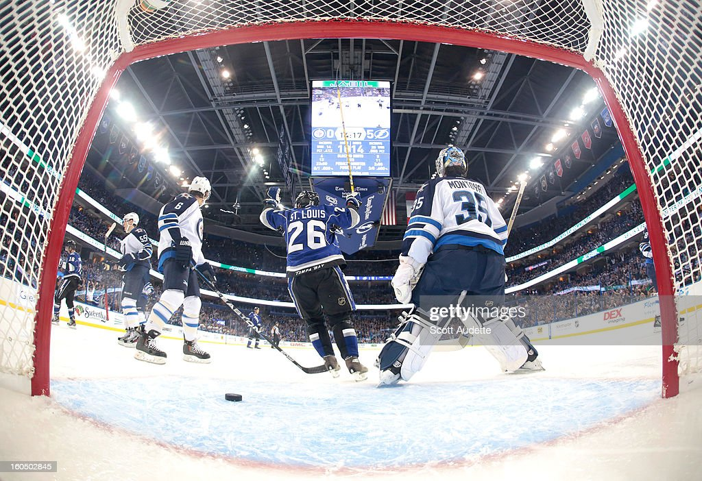<a gi-track='captionPersonalityLinkClicked' href=/galleries/search?phrase=Martin+St.+Louis&family=editorial&specificpeople=202067 ng-click='$event.stopPropagation()'>Martin St. Louis</a> #26 of the Tampa Bay Lightning celebrates after a Lightning goal during the second period of the Tampa Bay Lightning game against the Winnipeg Jets at the Tampa Bay Times Forum on February 1, 2013 in Tampa, Florida.
