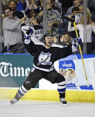 Martin St Louis of the Tampa Bay Lightning celebrates his game winning goal over the New York Islanders during overtime in the first round of the...