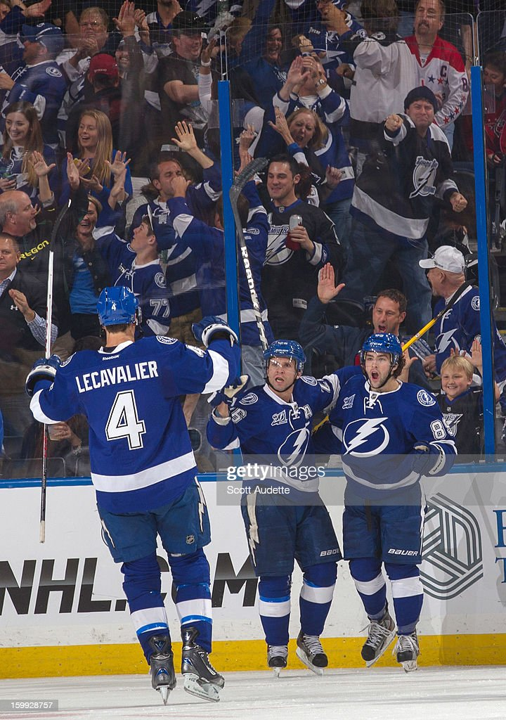 Martin St. Louis #26 of the Tampa Bay Lightning celebrates his goal with teammates Vincent Lecavalier #4 and Cory Conacher #89 against the Washington Capitals at the Tampa Bay Times Forum on January 19, 2013 in Tampa, Florida.