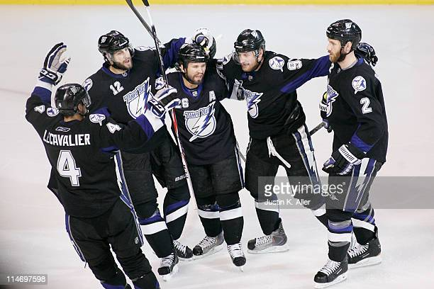 Martin St Louis of the Tampa Bay Lightning celebrates his second period goal with teammates in Game Six of the Eastern Conference Finals against the...