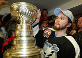 Martin St Louis of the Tampa Bay Lightning celebrates with the Stanley Cup in the locker room after defeating the Calgary Flames in game seven of the...