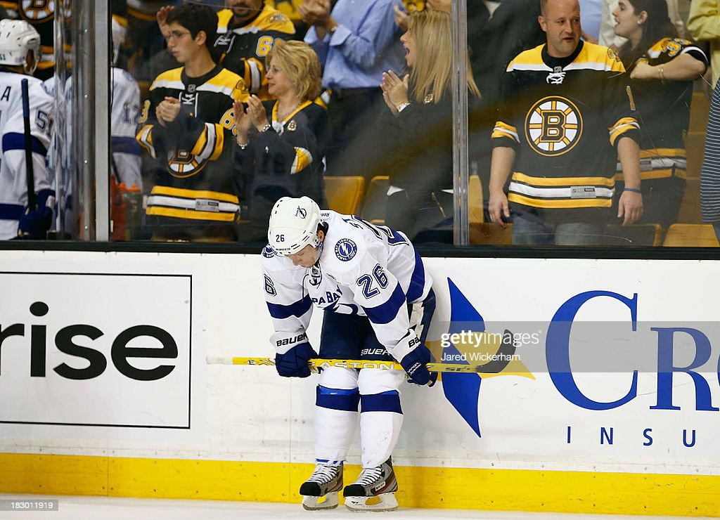<a gi-track='captionPersonalityLinkClicked' href=/galleries/search?phrase=Martin+St.+Louis&family=editorial&specificpeople=202067 ng-click='$event.stopPropagation()'>Martin St. Louis</a> #26 of the Tampa Bay Lightning hunches over following their 3-1 loss to the Boston Bruins during the home opener game on October 3, 2013 at TD Garden in Boston, Massachusetts.