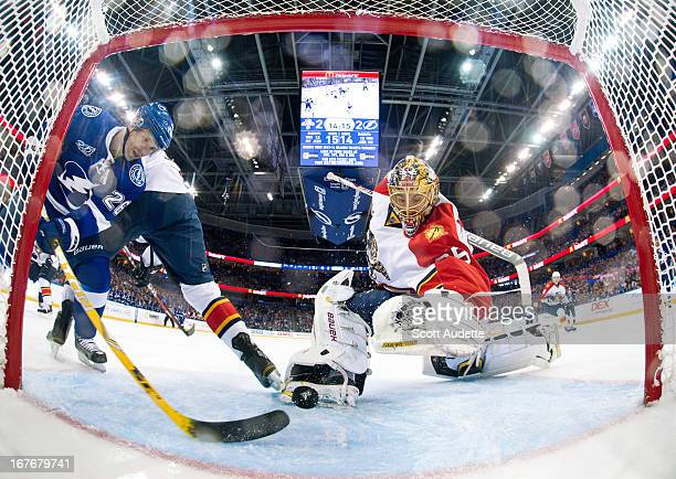 Martin St Louis of the Tampa Bay Lightning jams the puck in on a rebound during the second period of the game against the Florida Panthers at the...