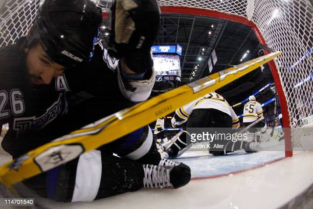 Martin St Louis of the Tampa Bay Lightning lays in the goal as Steven Stamkos of the Tampa Bay Lightning scores a third period goal against Tim...