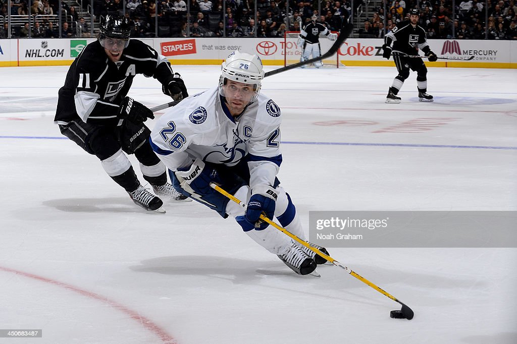 Martin St. Louis #26 of the Tampa Bay Lightning skates with the puck during his 1000th career NHL game against the Los Angeles Kings at Staples Center on November 19, 2013 in Los Angeles, California.