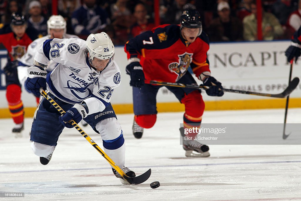 Martin St. Louis #26 of the Tampa Bay Lightning skates with the puck against the Florida Panthers at the BB&T Center on February 16, 2013 in Sunrise, Florida.