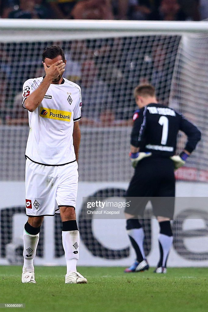 Martin Stranzl and MarcAndré ter Stegen of Moenchengladbach look dejected after the third goal of Kiew during the UEFA Champions League playoff first...