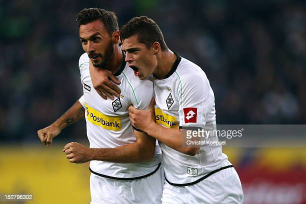 Martin Stranzl celebrates the first goal with Granit Xhaka of Moenchengladbach during the Bundesliga match between Borussia Moenchengladbach and...
