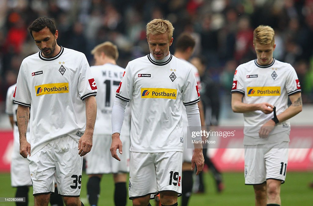 Martin Stranzl Mike Hanke and Marco Reus of Gladbach look dejected after the Bundesliga match between Hannover 96 and Borussia Moenchengladbach at...