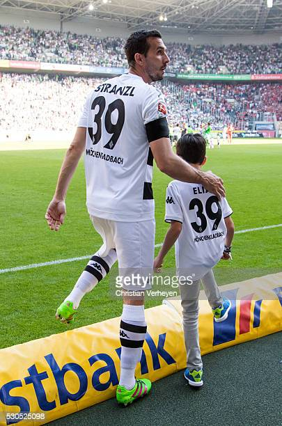 Martin Stranzl of Borussia Moenchengladbach with his son Elias after the Bundesliga match between Borussia Moenchengladbach and Bayer Leverkusen at...