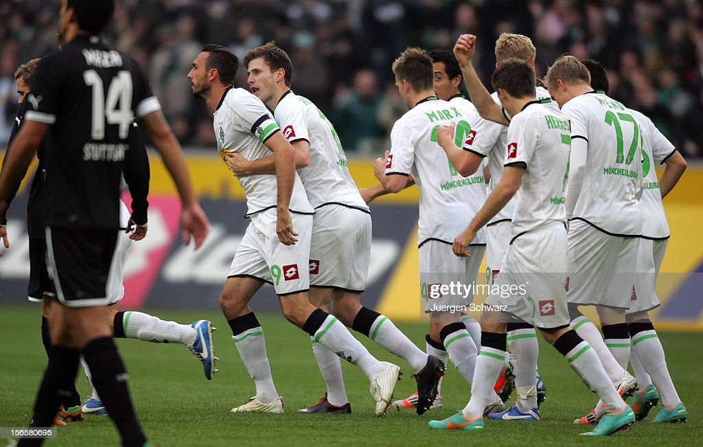<a gi-track='captionPersonalityLinkClicked' href=/galleries/search?phrase=Martin+Stranzl&family=editorial&specificpeople=674140 ng-click='$event.stopPropagation()'>Martin Stranzl</a> (L) of Gladbach celebrates with teammates after scoring at the Bundesliga match between Borussia Moenchengladbach and VfB Stuttgart at Borussia Park Stadium on November 17, 2012 in Moenchengladbach, Germany.