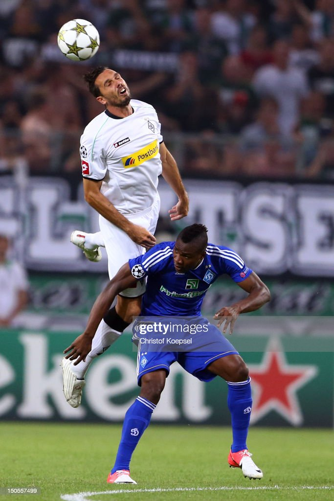 Martin Stranzl of Moenchengladbach and Ideye Brown of Kiew go up for a header during the UEFA Champions League playoff first leg match between...