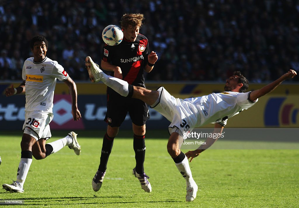 Martin Stranzl of Moenchengladbach and Stefan Kiessling of Leverkusen battle for the ball during the Bundesliga match between Borussia...