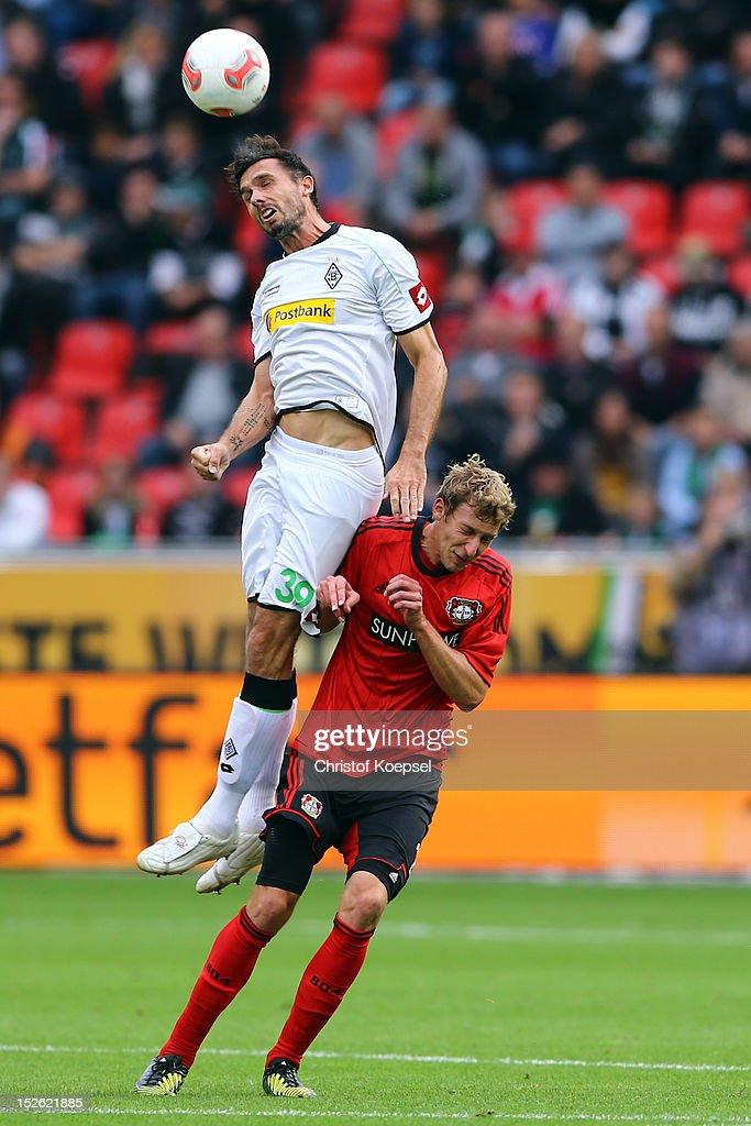 Martin Stranzl of Moenchengladbach and Stefan Kiessling of Leverkusen go up for a header during the Bundesliga match between Bayer 04 Leverkusen and...