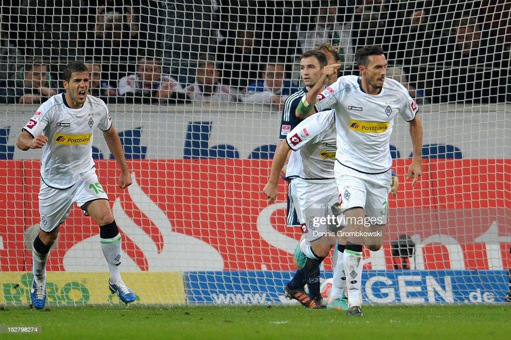 Martin Stranzl of Moenchengladbach celebrates after scoring his team's first goal during the Bundesliga match between Borussia Moenchengladbach and...