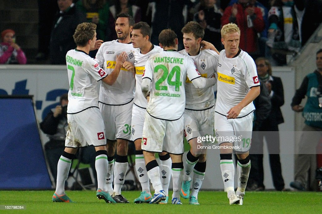 Martin Stranzl of Moenchengladbach celebrates with teammates after scoring his team's first goal during the Bundesliga match between Borussia...