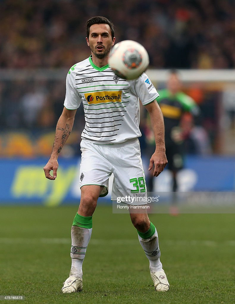 <a gi-track='captionPersonalityLinkClicked' href=/galleries/search?phrase=Martin+Stranzl&family=editorial&specificpeople=674140 ng-click='$event.stopPropagation()'>Martin Stranzl</a> of Moenchengladbach focusses the ball during the Bundesliga match between Eintracht Braunschweig and Borussia Moenchengladbach at Eintracht Stadion on March 1, 2014 in Braunschweig, Germany.