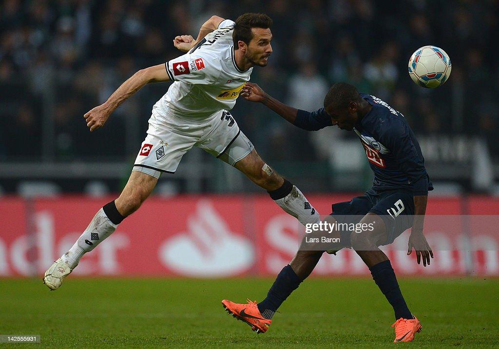Martin Stranzl of Moenchengladbach is challenged by Ramos Vasquez of Berlin during the Bundesliga match between Borussia Moenchengladbach and Hertha...