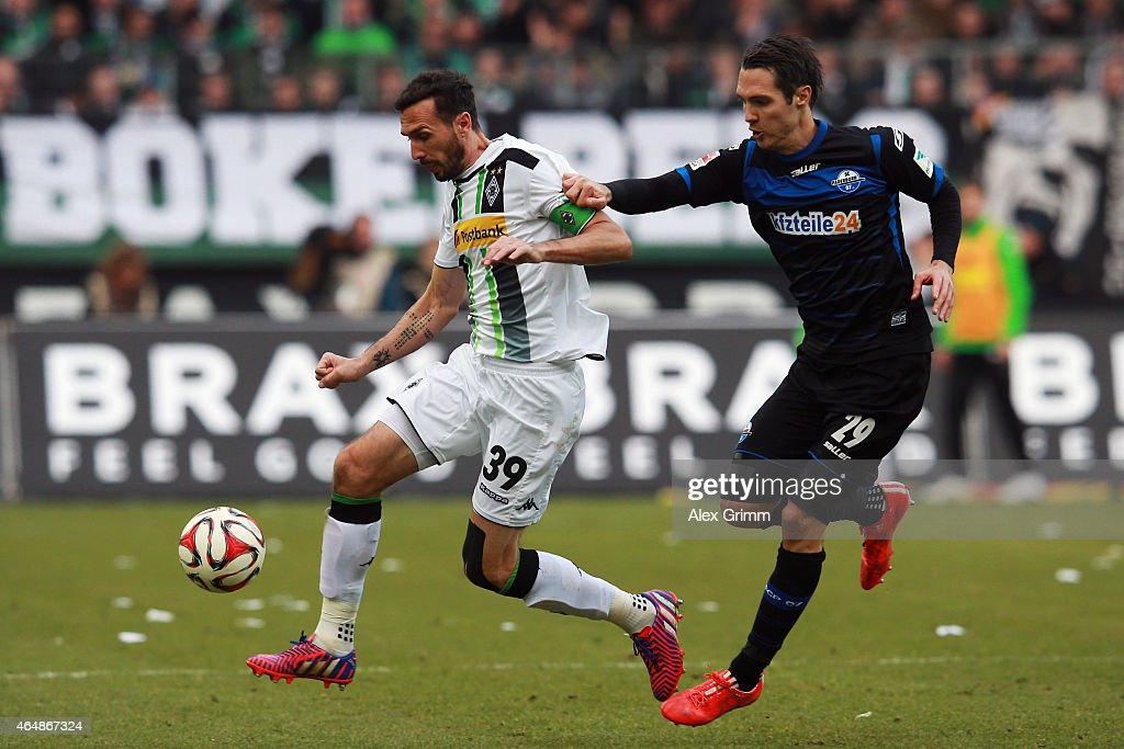 Martin Stranzl of Moenchengladbach is challenged by Srdjan Lakic of Paderborn during the Bundesliga match between Borussia Moenchengladbach and SC...