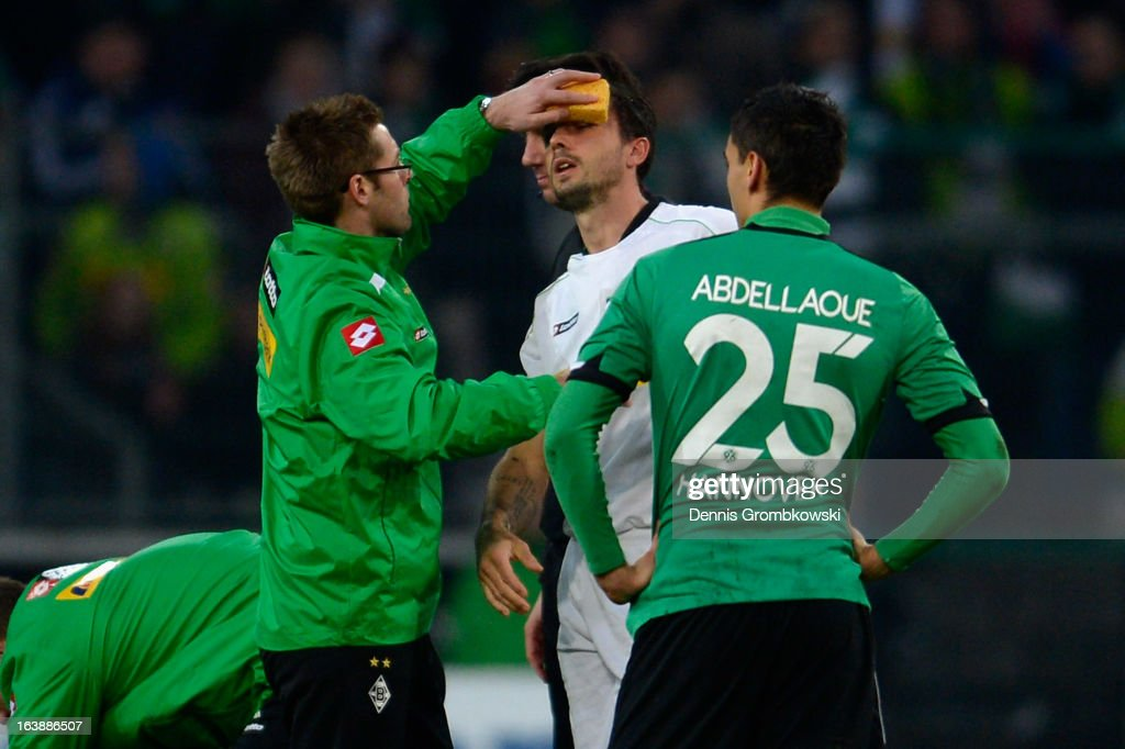 Martin Stranzl of Moenchengladbach is treated after suffering an injury during the Bundesliga match between VfL Borussia Moenchengladbach and...