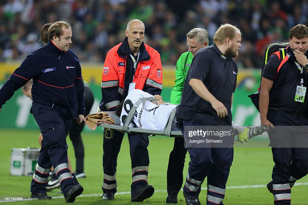 Martin Stranzl of Moenchengladbach lies on a stretcher when he is carried off the pitch during the Bundesliga match between Borussia Moenchengladbach...