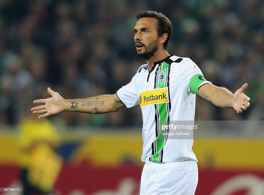 Martin Stranzl of Moenchengladbach lifts his arms during the Bundesliga match between Borussia Moenchengladbach and Hamburger SV at BorussiaPark on...