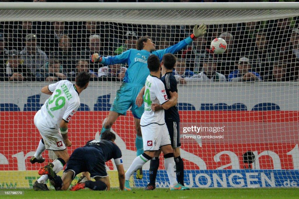 Martin Stranzl of Moenchengladbach scores his team's first goal during the Bundesliga match between Borussia Moenchengladbach and Hamburger SV at...