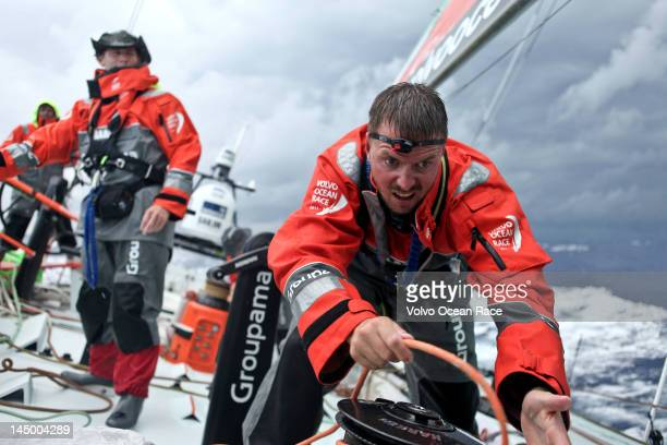 Martin Stromberg from Sweden on the winch as Groupama Sailing Team perform manoeuvres during leg 7 of the Volvo Ocean Race 201112 from Miami USA to...