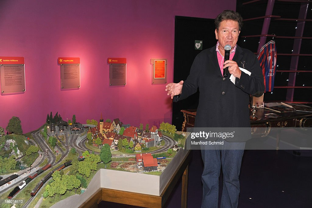 Martin Suppan (L) poses next to a toy train of Peter Alexander during a press event for the Peter Alexander charity auction at Madame Tussauds on October 29, 2013 in Vienna, Austria.