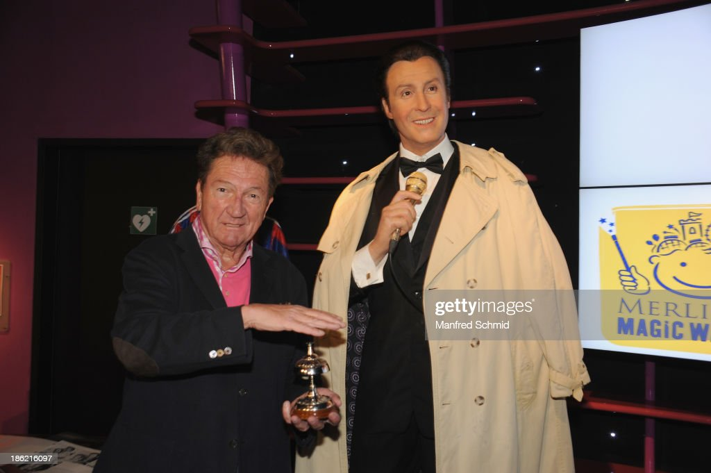 Martin Suppan (L) poses next to a waxfigure of Peter Alexander during a press event for the Peter Alexander charity auction at Madame Tussauds on October 29, 2013 in Vienna, Austria.