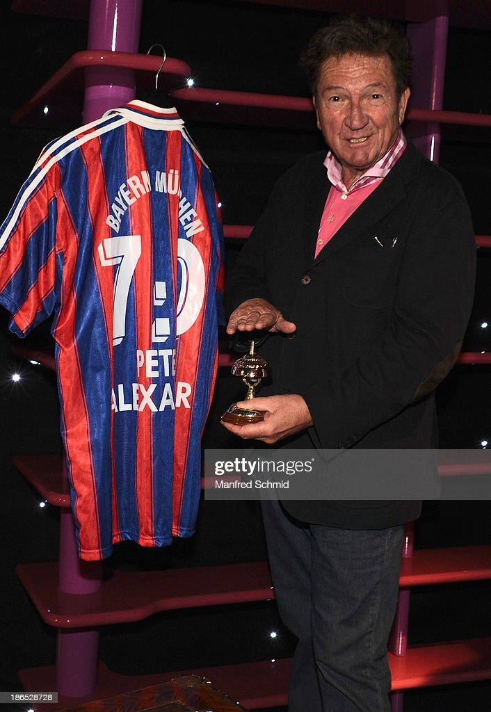 Martin Suppan speaks to the audience next to a soccer shirt during a press event for the Peter Alexander charity auction at Madame Tussauds on October 29, 2013 in Vienna, Austria.