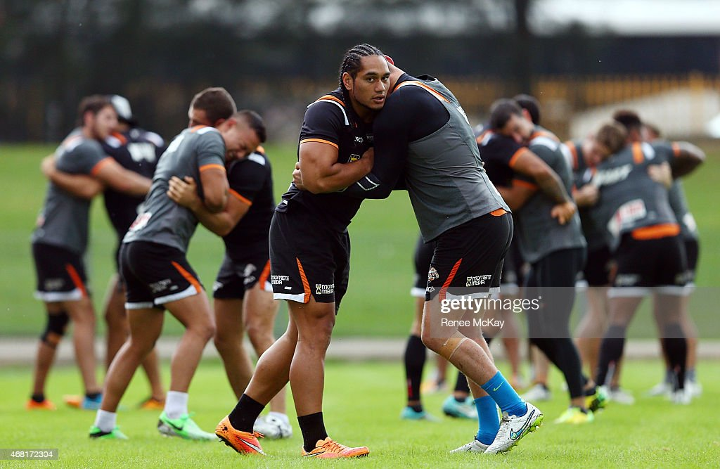 Martin Taupau and Jack Buchannan warm up during a Wests Tigers NRL training session at Leichhardt Oval on March 31, 2015 in Sydney, Australia.
