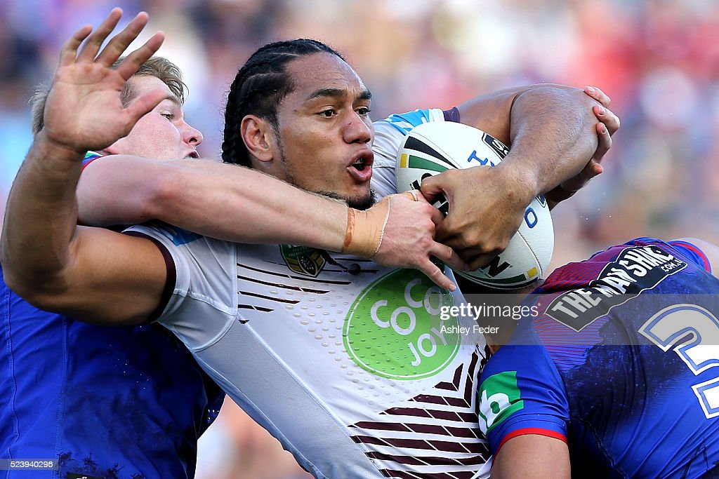 Martin Taupau of Manly is tackled by the Knights defence during the round eight NRL match between the Newcastle Knights and the Manly Sea Eagles at Hunter Stadium on April 25, 2016 in Newcastle, Australia.