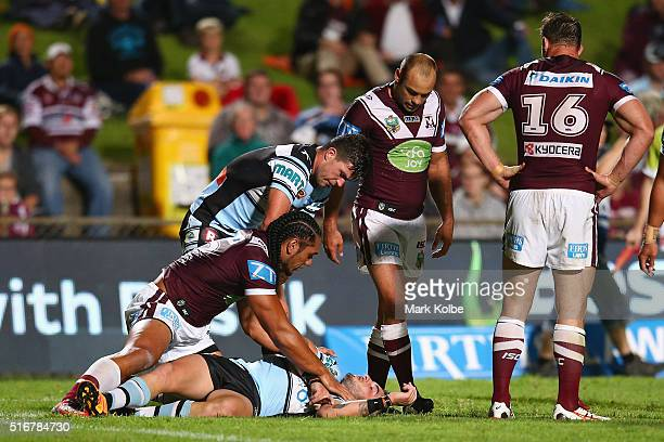 Martin Taupau of the Eagles and Chad Townsend of the Sharks show concern for Jack Bird of the Sharks as he lies injured on the ground during the...