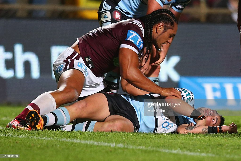 Martin Taupau of the Eagles shows concern for Jack Bird of the Sharks as he lies injured on the ground during the round three NRL match between the Manly Sea Eagles and the Cronulla Sharks at Brookvale Oval on March 21, 2016 in Sydney, Australia.