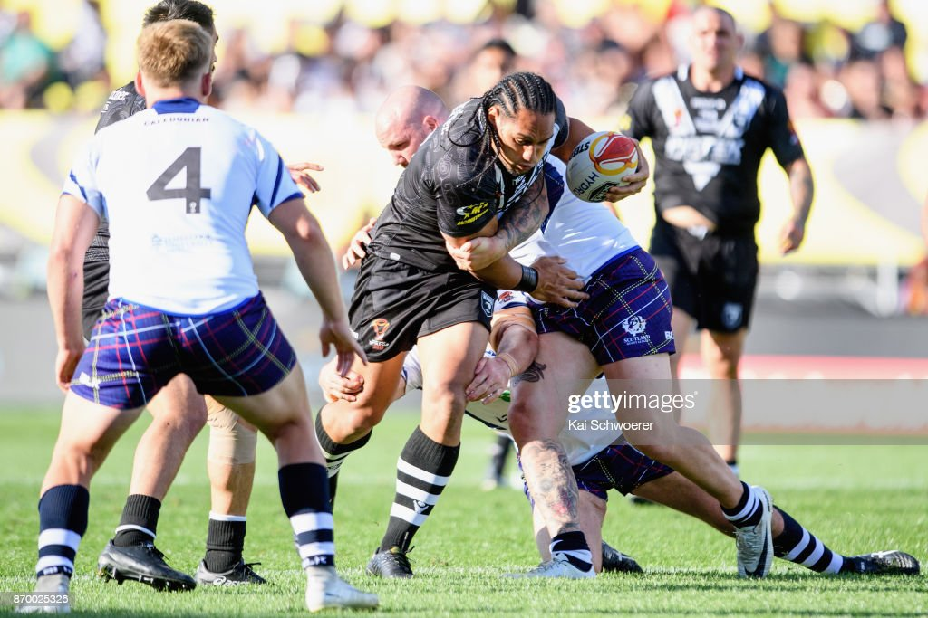 Martin Taupau of the Kiwis is tackled by Dale Ferguson of Scotland during the 2017 Rugby League World Cup match between the New Zealand Kiwis and Scotland at AMI Stadium on November 4, 2017 in Christchurch, New Zealand.