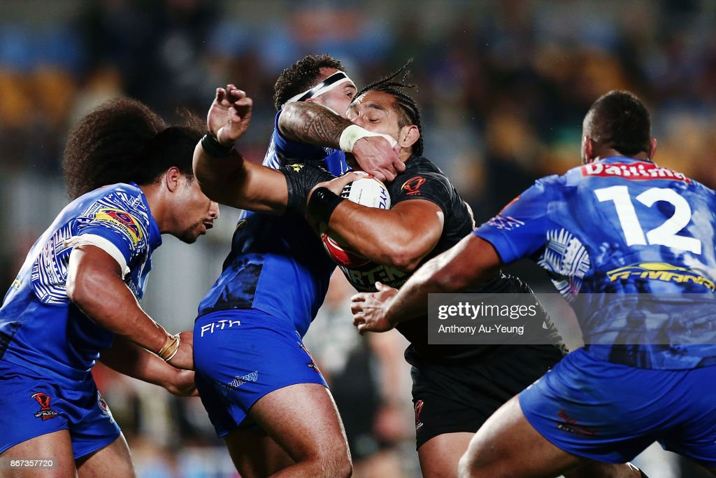 Martin Taupau of the Kiwis is tackled by Jazz Tevaga of Samoa during the 2017 Rugby League World Cup match between the New Zealand Kiwis and Samoa at Mt Smart Stadium on October 28, 2017 in Auckland, New Zealand.