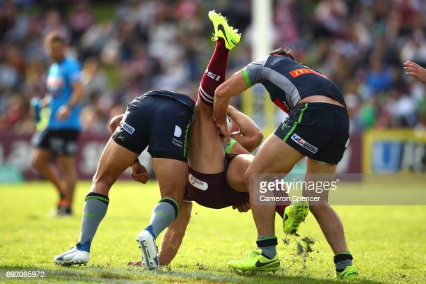 Martin Taupau of the Sea Eagles is tackled during the round 13 NRL match between the Manly Sea Eagles and the Canberra Raiders at Lottoland on June 4...