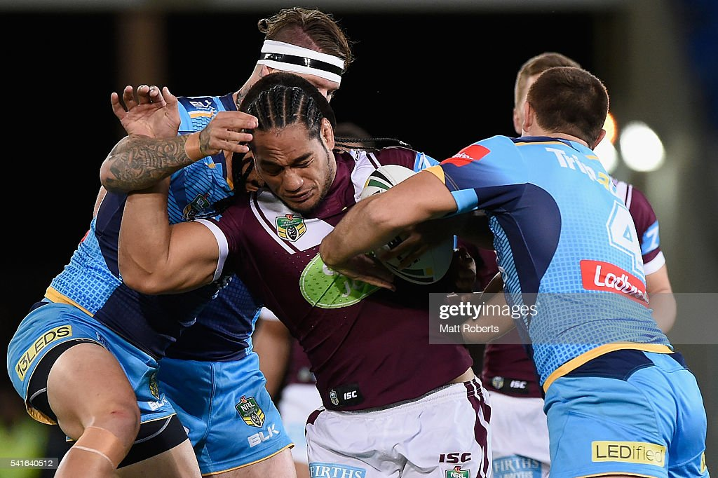 Martin Taupau of the Sea Eagles is tackled during the round 15 NRL match between the Gold Coast Titans and the Manly Sea Eagles at Cbus Super Stadium on June 20, 2016 in Gold Coast, Australia.