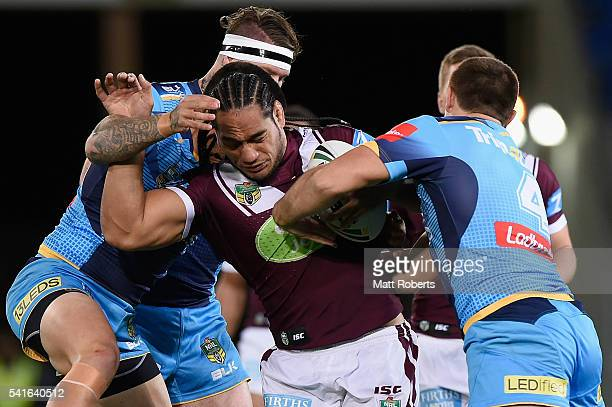 Martin Taupau of the Sea Eagles is tackled during the round 15 NRL match between the Gold Coast Titans and the Manly Sea Eagles at Cbus Super Stadium...