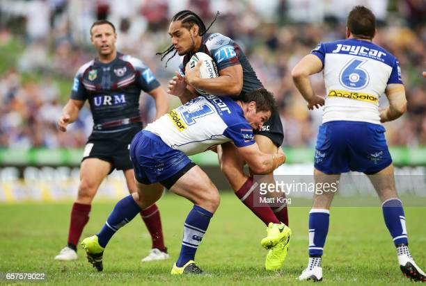 Martin Taupau of the Sea Eagles is tackled during the round four NRL match between the Manly Warringah Sea Eagles and the Canterbury Bulldogs at...