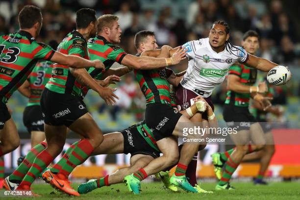 Martin Taupau of the Sea Eagles is tackled during the round nine NRL match between the South Sydney Rabbitohs and the Manly Sea Eagles at Allianz...