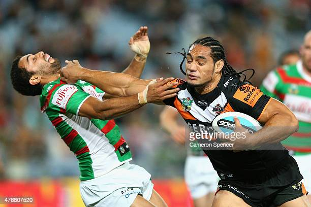 Martin Taupau of the Tigers breaks through a tackle during the round 14 NRL match between the Wests Tigers and the South Sydney Rabbitohs at ANZ...