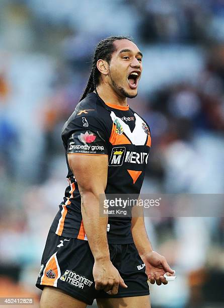 Martin Taupau of the Tigers celebrates victory at the end of the round 19 NRL match between the Wests Tigers and the Canterbury Bulldogs at ANZ...