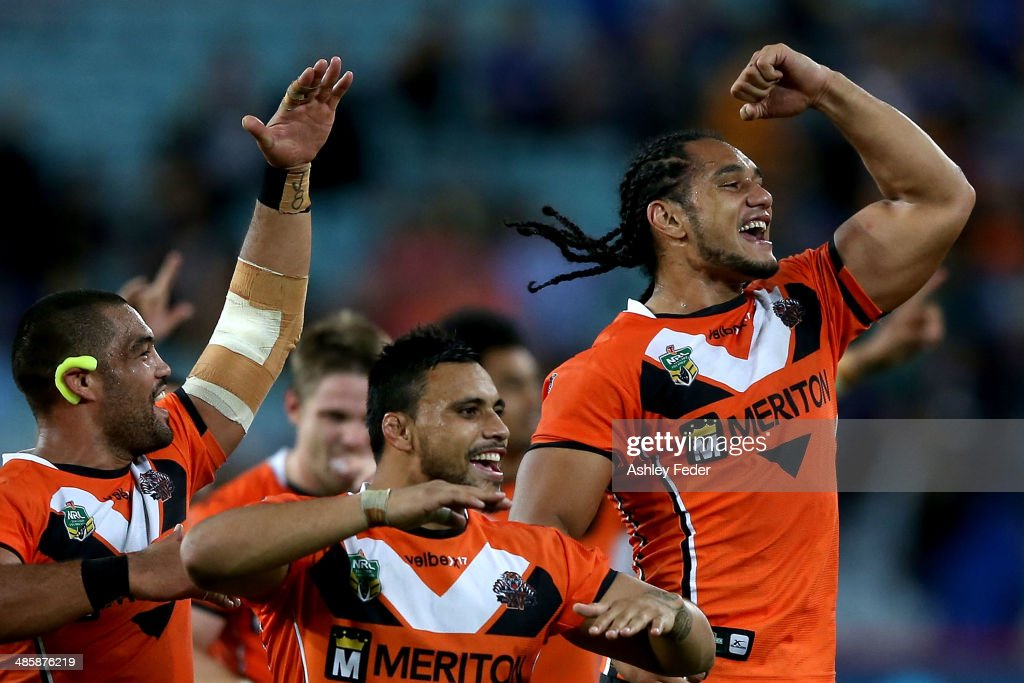 Martin Taupau of the Tigers celebrates with teammates after winning during the round seven NRL match between the Parramatta Eels and the Wests Tigers at ANZ Stadium on April 21, 2014 in Sydney, Australia.